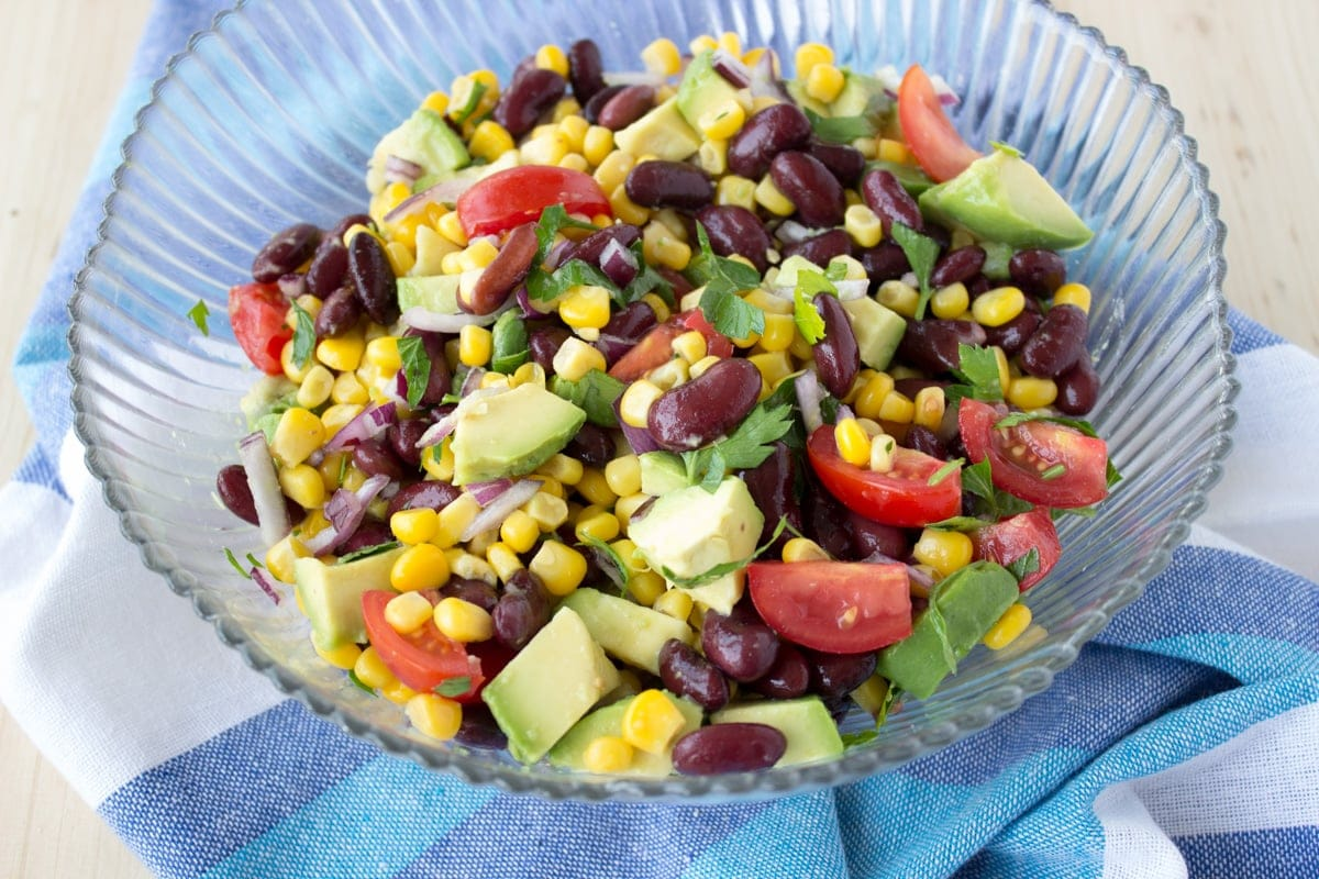 Black Bean Corn Avocado Salad with lime dressing served with homemade tortilla chips