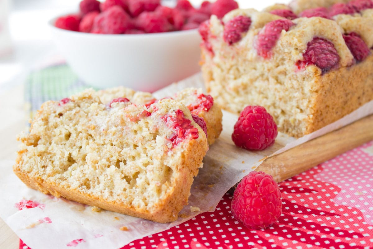 Fragrant and sweet with a touch of tangy fruity freshness makes this Raspberry Lemon Cake irresistible summer dessert. The cake is prepared with all healthy ingredients and moderate in calories, so you can enjoy worry-free in few extra bites of this delicious cake. CLICK to read more, or PIN for later!