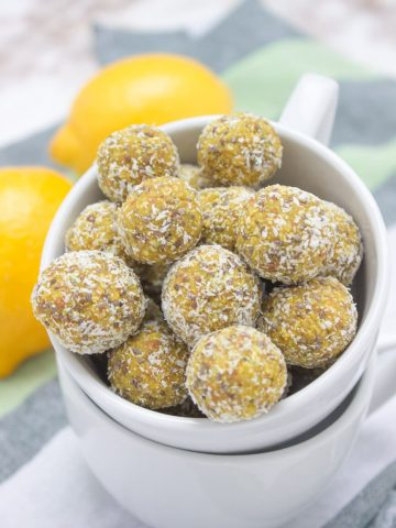 Lemon Turmeric Energy Balls full of beautiful citrus aroma enriched with healing spice - TURMERIC, and superfood - CHIA SEEDS. These immune boosting, refined sugar-free energy balls are rich in fibers and plant-based proteins. Perfect for everyday snacking. #vegan #glutenfree #healthy #turmeric #chia #lowcarb #nosugar #sugarfree #raw #nobake #balls | www.natalieshealth.com