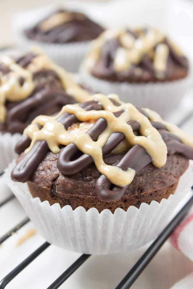 Double Chocolate Banana Muffins made with all HEALTHY ingredients, refined sugar-free, filled with dark chocolate and peanut butter. Perfect afternoon dessert, kids school snack or quick breakfast. CLICK to read more or PIN for later! [natalieshelath.com] #healthy #sugarfree #chocolate #DairyFree #Whole30