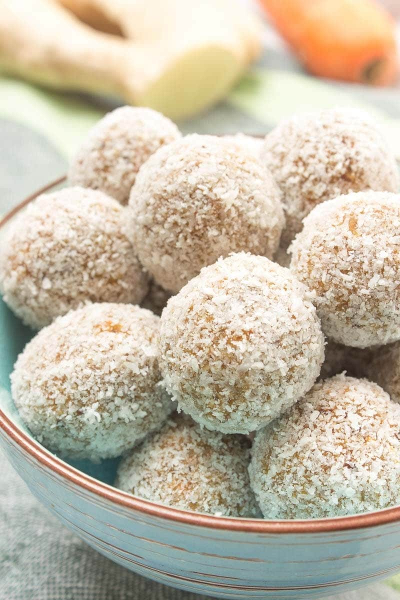 Raw no-bake Carrot Cake Energy Balls made with all HEALTHY ingredients. These yummy bites are refined sugar-free, gluten-free and vegan. Perfect snack, a post-workout snack or simple dessert.   natalieshealth.com   #vegan #glutenfree #sugarfree #Easter #healthy #easy #whole30
