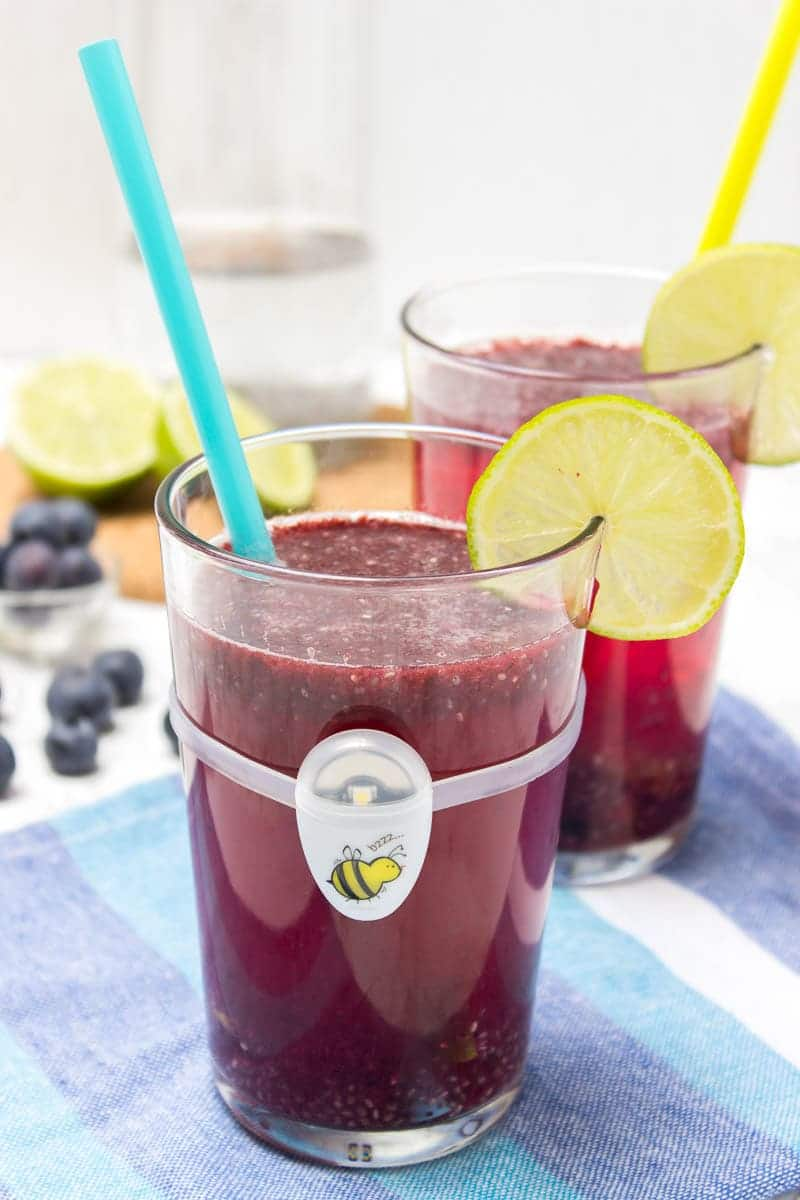 Energizing Blueberry Lime Chia Fresca made with fresh fruits and full of HEALTHY nutrients. It's refreshing, sweet and just delicious. Contains only natural ingredients and NO REFINED sugars. Perfect summertime drink. #chia #vegan #glutenfree #sugarfree #weightloss #healthy #drinks #summer #party #kids | natalieshealth.com