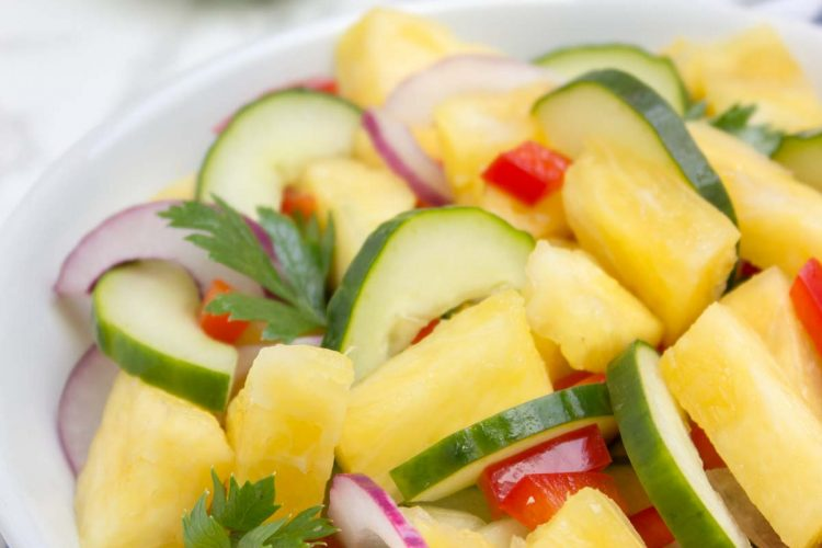 Juicy and refreshing Pineapple Cucumber Salad is a super HEALTHY way to cool down this summer! This salad is easy to make, bursting with fresh summer flavors and full of nutrients. Perfect side for summer BBQs and parties! #summer #BBQ #picnic #party #glutenfree #vegan #salad #healthy #lowcalorie #weightloss #fit #kidsfriendly | natalieshealth.com