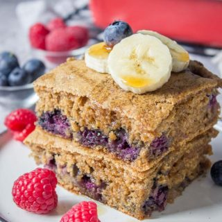 Healthy oven baked Blueberry Pancake Casserole topped with banana and raspberries