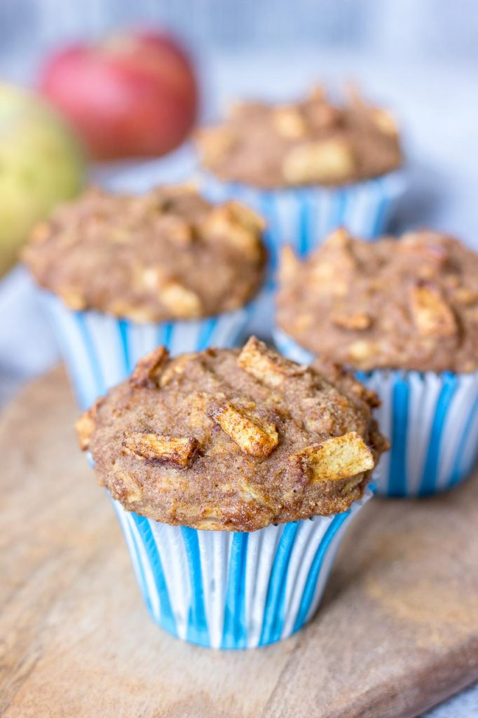 Apple Cinnamon Muffins made with fresh apples served on a wooden plate
