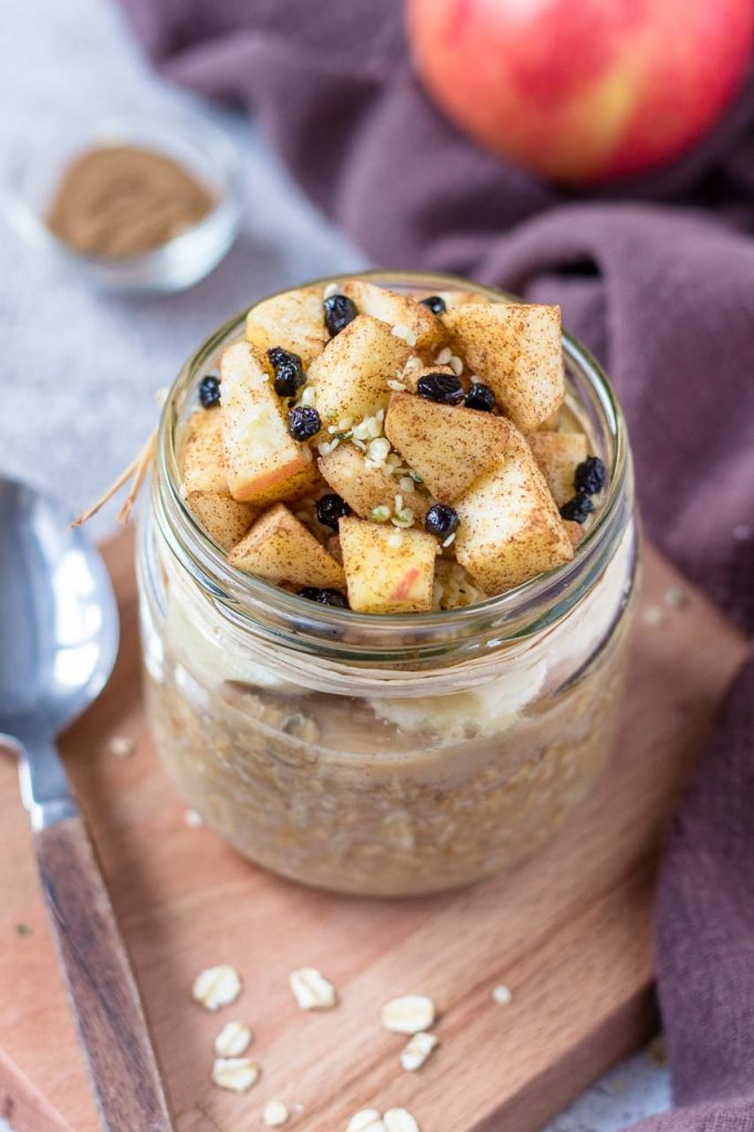 Apple Cinnamon Overnight Oats served in a jar topped with fresh chopped apples