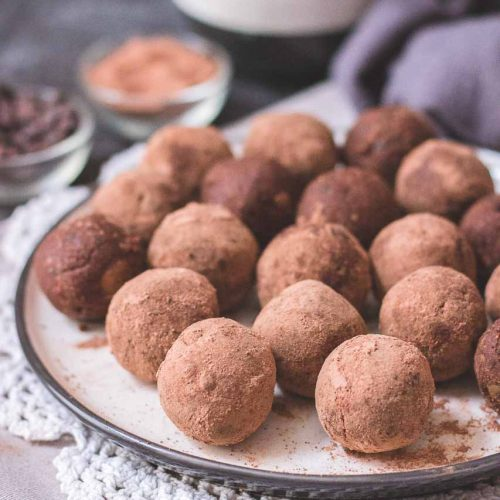 Chocolate No Bake Brownie Bites rolled in cacao powder