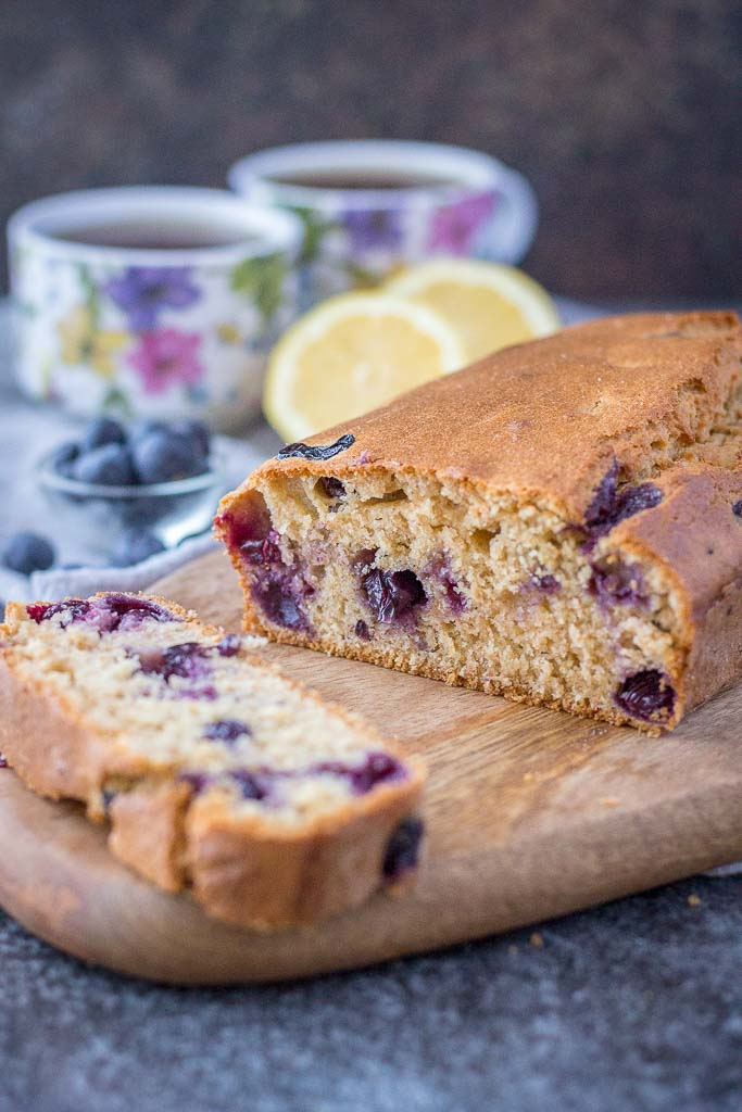 Healthy whole grain refined sugar-free Lemon Blueberry Pound Cake with fresh blueberries