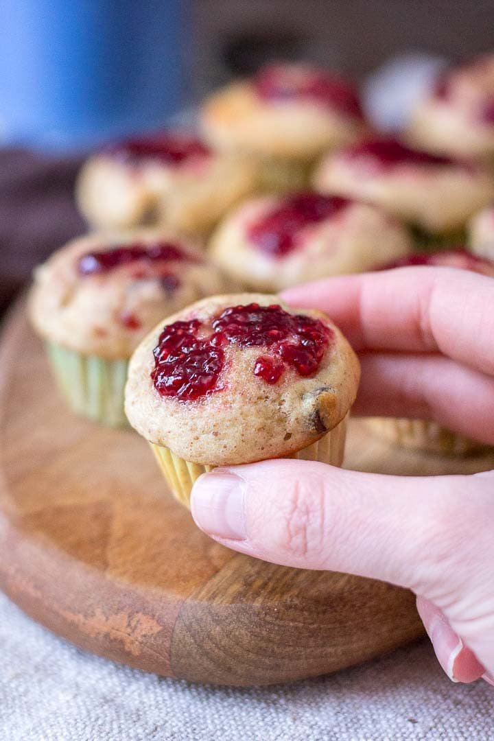 Mini Peanut Butter Banana Muffins with chocolate chips topped with raspberry jam