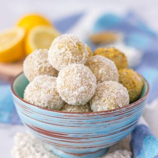 Healthy Lemon Coconut Energy Balls with cashews coconut and hemp seeds sprinkled with shredded coconut and bee pollen