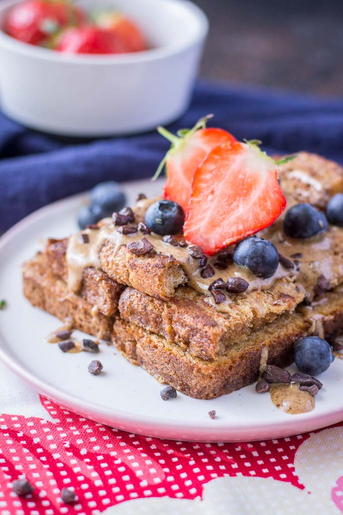 Healthy Cinnamon French Toast made with whole grain toast topped with almond butter and fruits