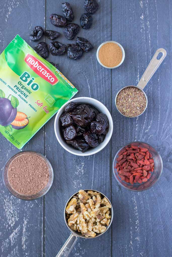 Ingredients for Energy Balls recipe with prunes walnuts and cacao
