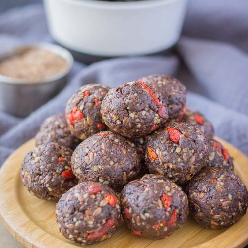 Chocolate Prune Energy Balls served on a wooden plate