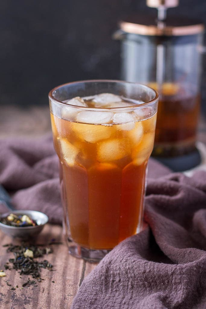 Cold Brewed Iced Earl Gray Latte served in a tall glass with ice cubes