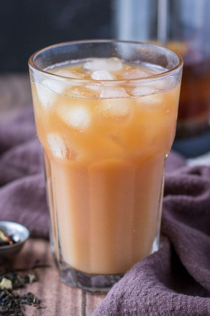 Cold Brewed Iced Earl Gray Latte with milk served in a tall glass with ice cubes