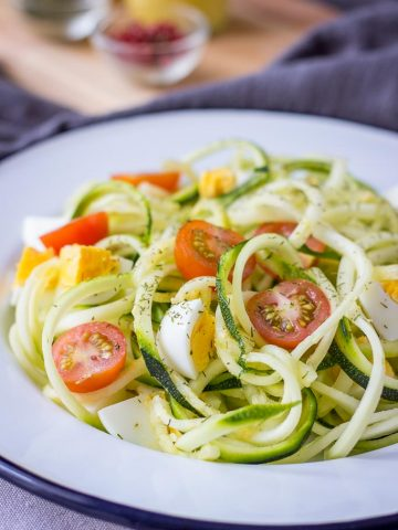Zucchini Noodle Salad with hard-boiled eggs cherry tomatoes and mustard flaxseed oil vinaigrette