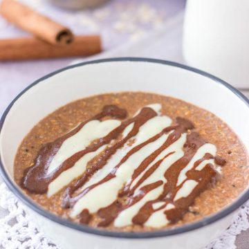 Cinnamon Roll Oatmeal porridge served in a bowl with cinnamon glaze and vanilla yogurt