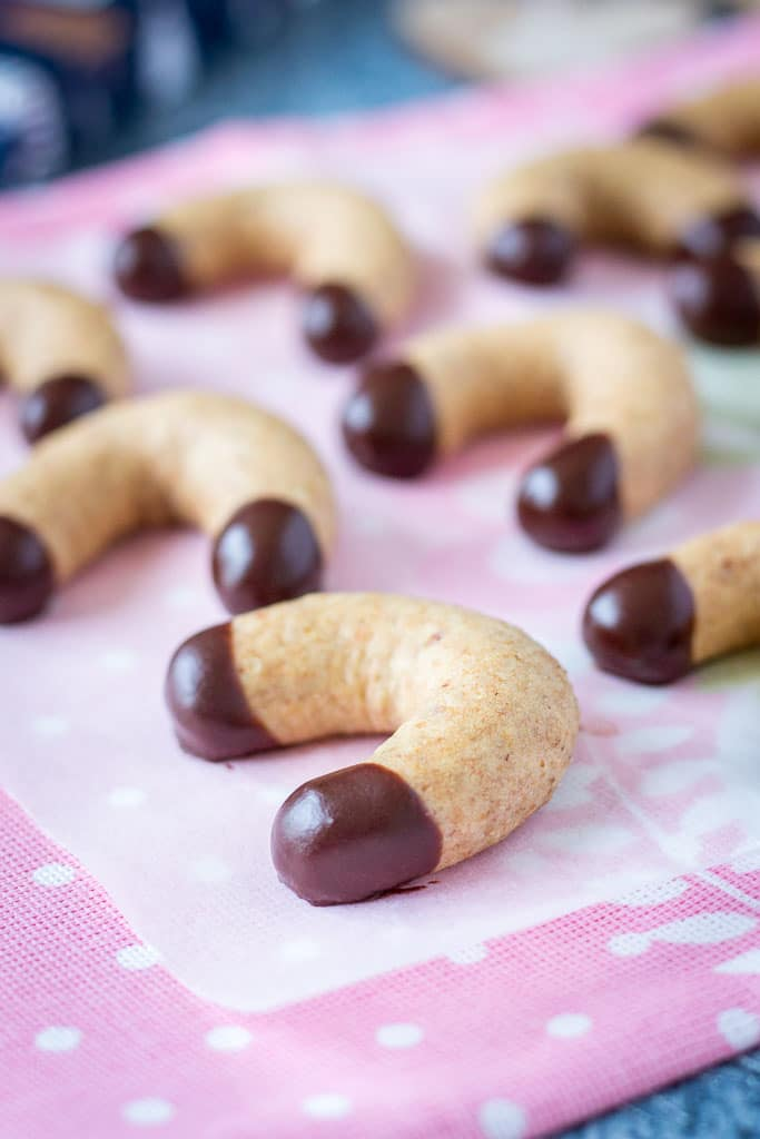 Healthy Vanilla Crescent Cookies made with ground almonds dipped in dark chocolate