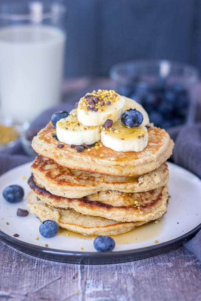 Blueberry Banana Pancakes recipe with oats topped with banana