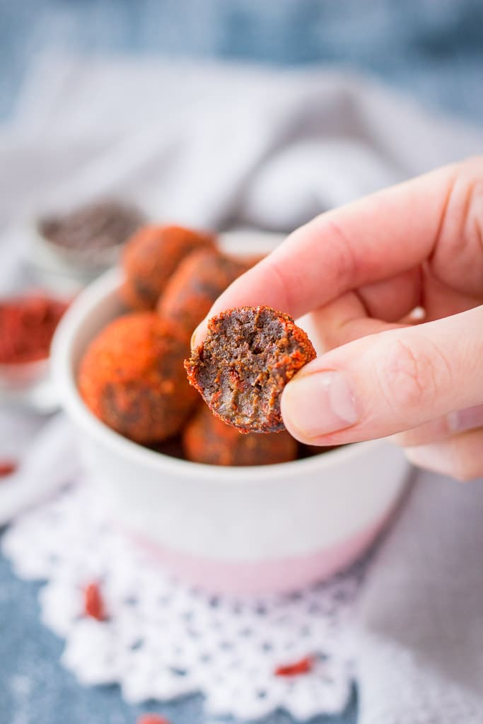 Maca bliss balls recipe with cacao, goji berries, and walnuts