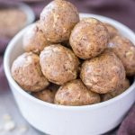 No Bake Peanut Butter Protein Balls with oats, peanut butter, and flax seeds served in a bowl