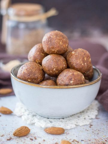 Easy No-Bake Almond Butter Energy Balls made with almonds and almond butter, served in a bowl