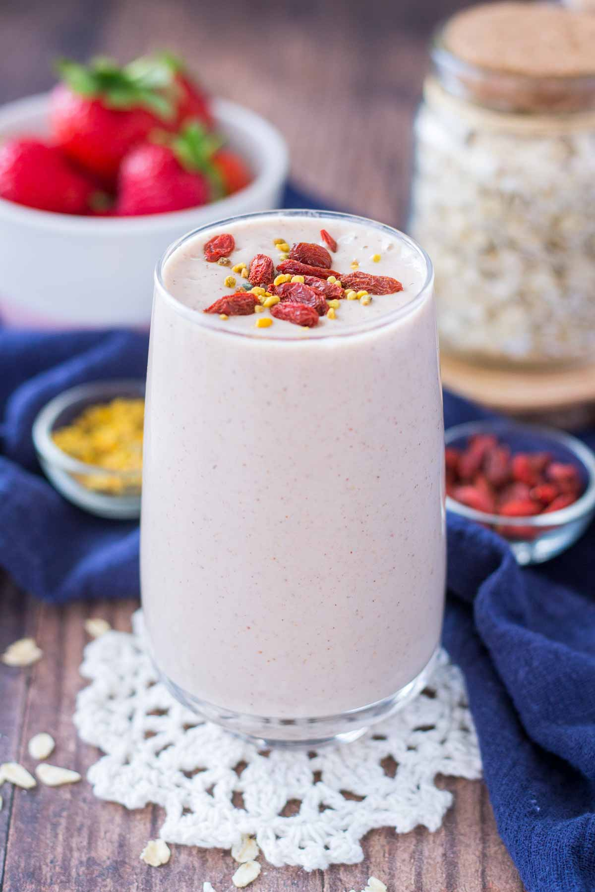 Strawberry Oatmeal Smoothie served in a glass topped with goji berries