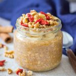 Pumpkin Overnight Oats topped with walnuts and goji berries