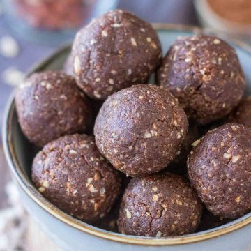 A closeup of a Chocolate Peanut Butter Balls served in a small bowl