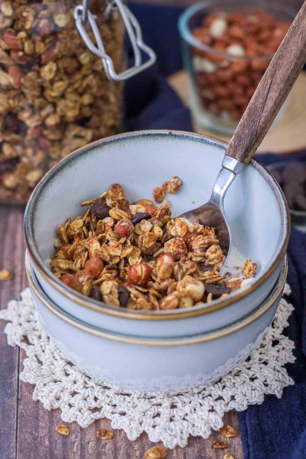 Homemade Peanut Butter Granola with a milk served in a bowl with a spoon