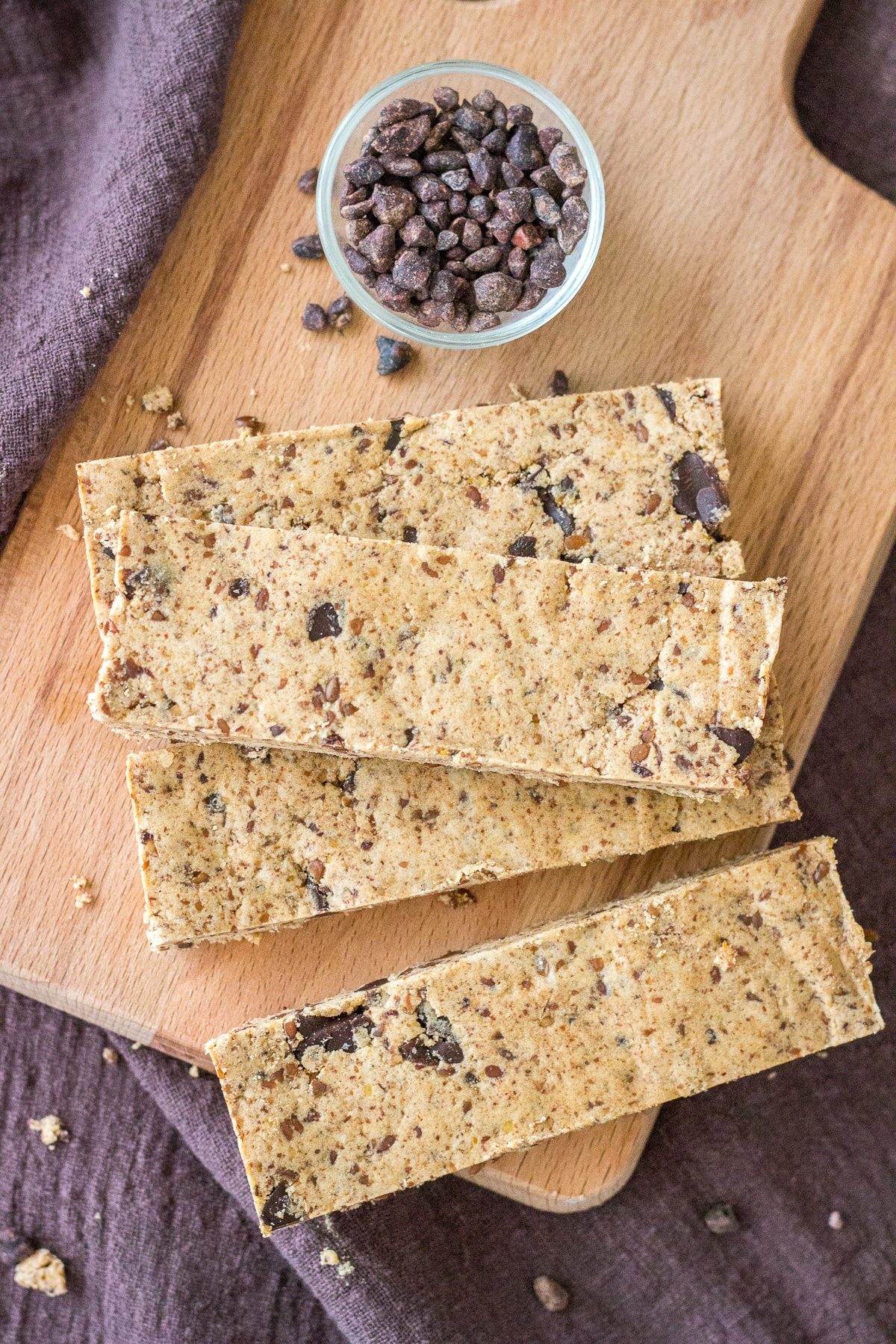 Upper view of a Cookie Dough Protein Bars served on a wooden plate