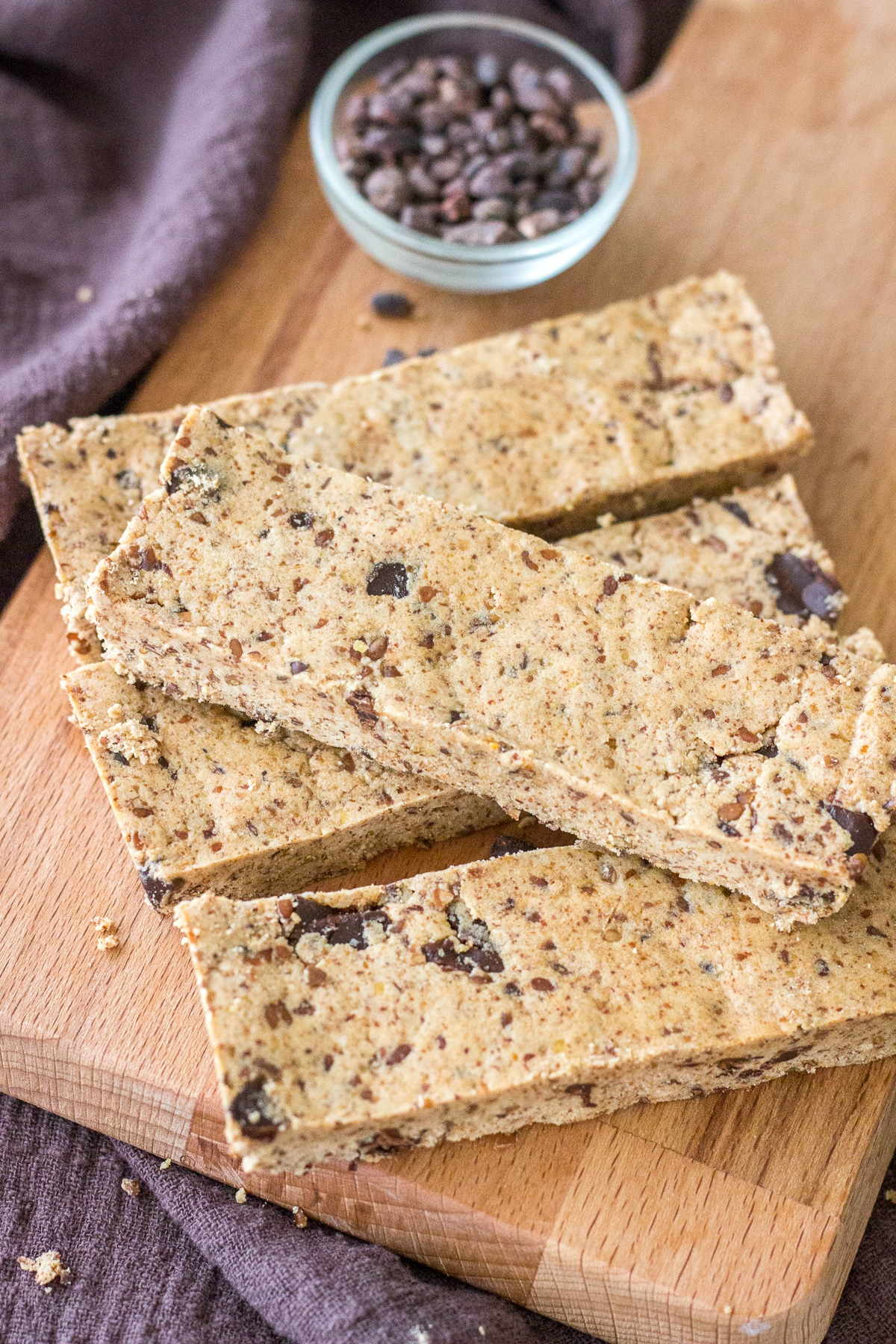 Cookie Dough Protein Bars served on a wooden plate