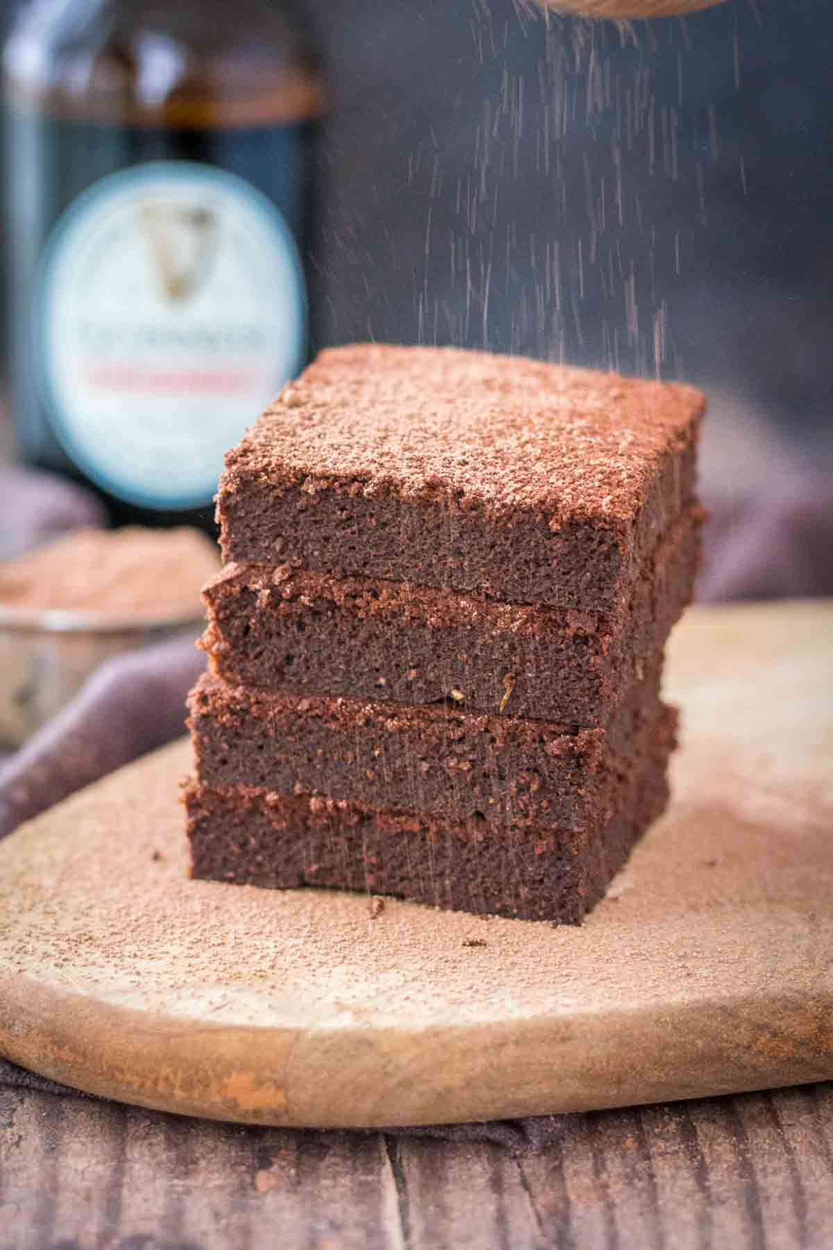 Dusting chocolate Guinness brownies with cacao powder