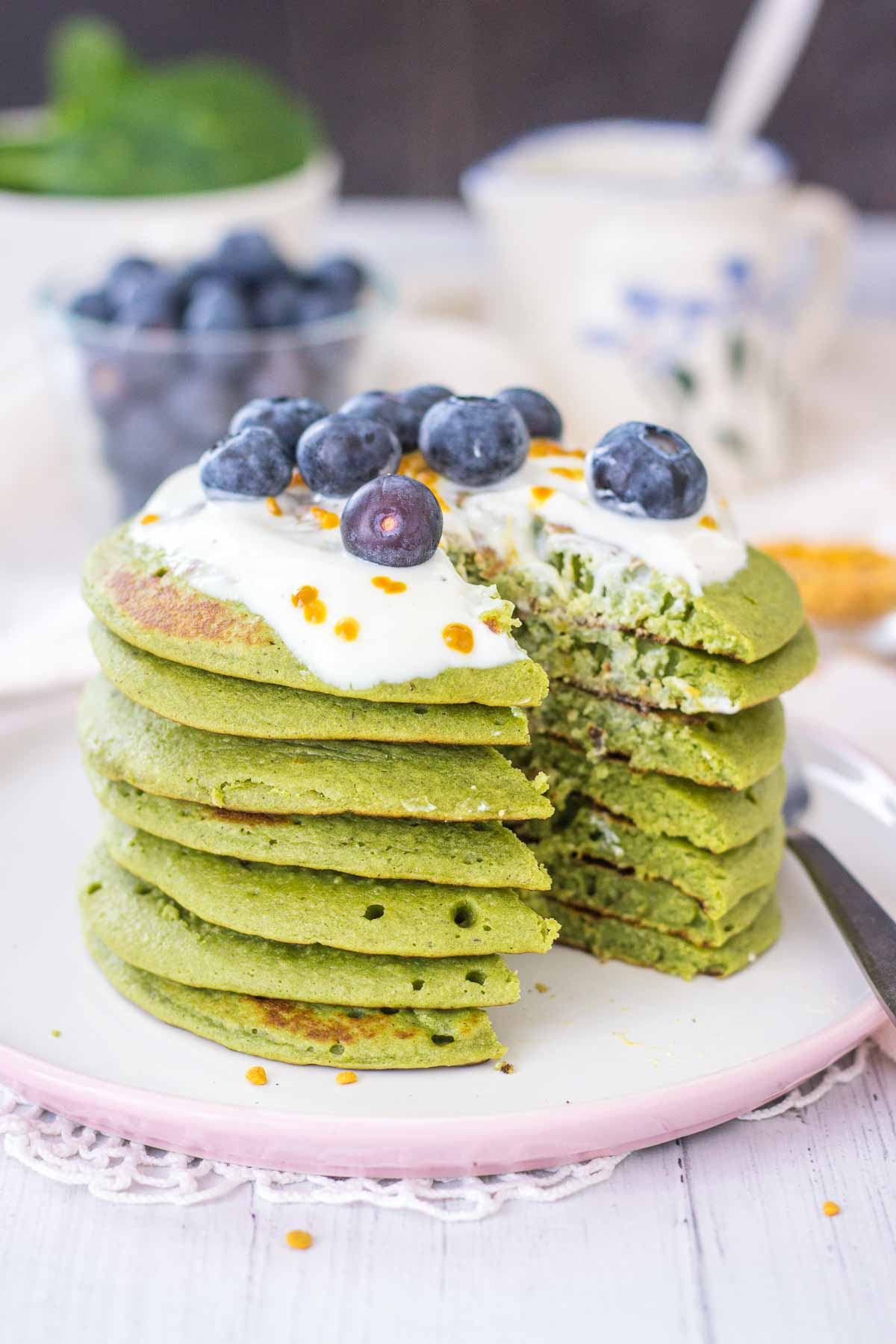 Matcha Pancakes topped with yogurt and blueberries.