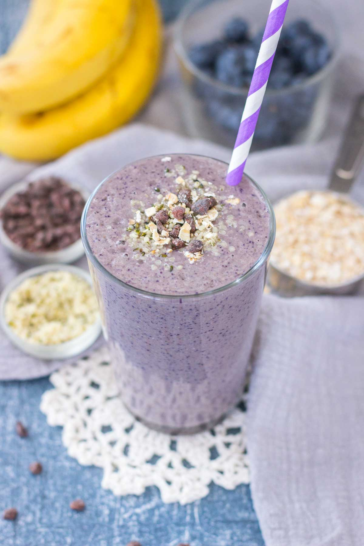 Healthy Blueberry Banana Smoothie with fresh fruits and oats served in a glass with a straw