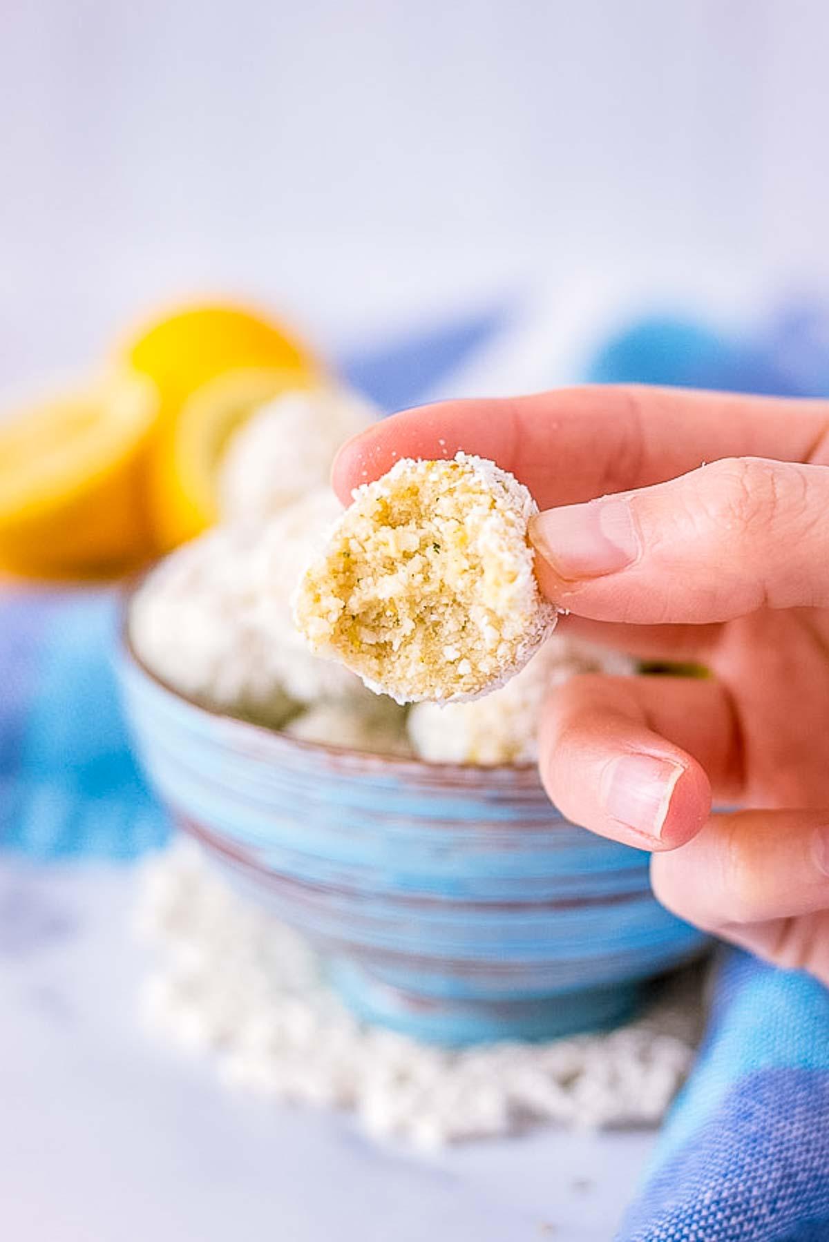 Hand holding Lemon Coconut Energy Balls