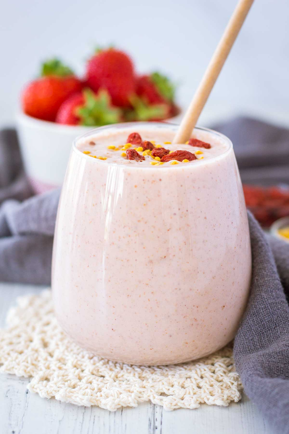 Strawberry Peanut Butter Smoothie served in a glass topped with goji berries