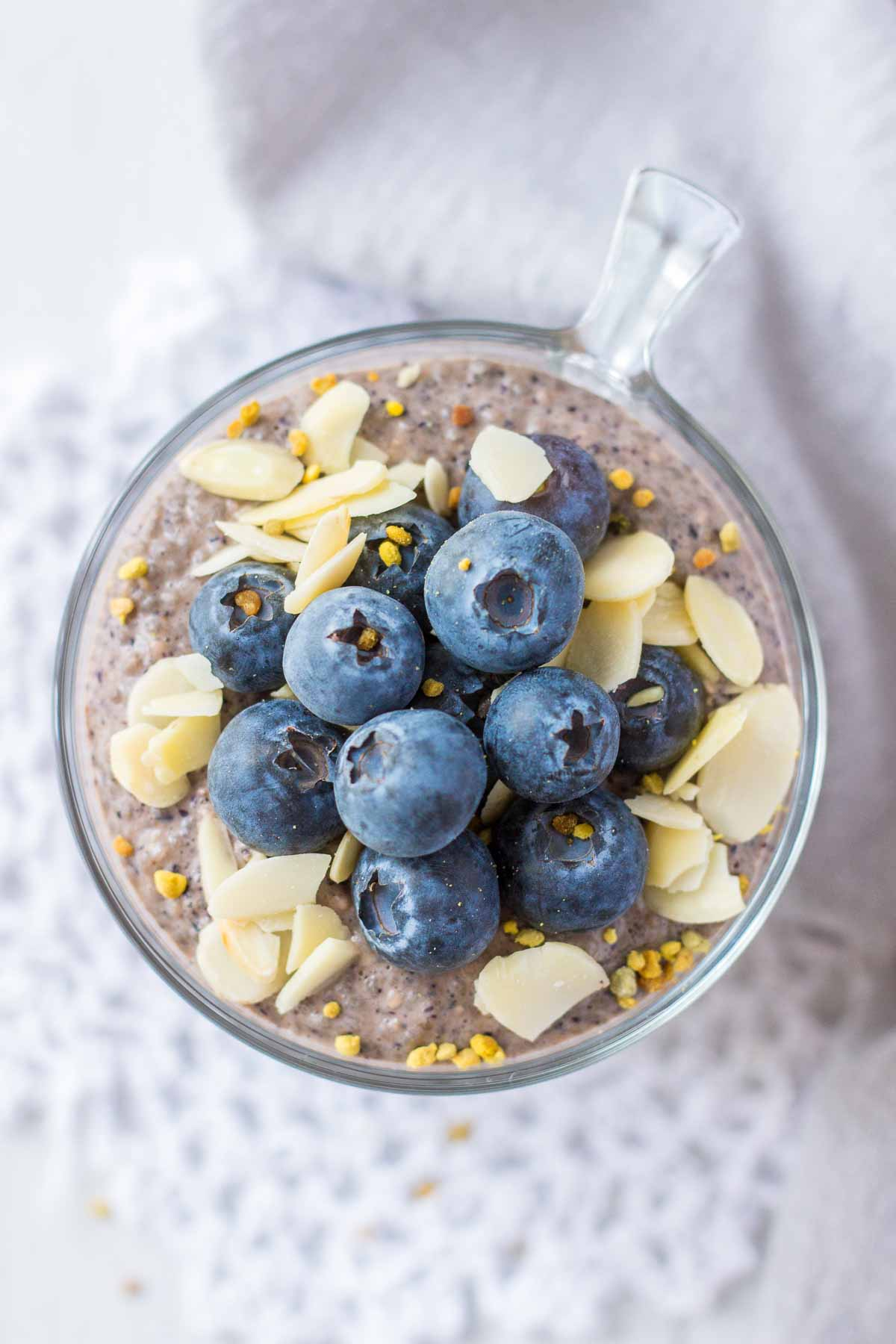 Upper view of Blueberry Chia Pudding served in a glass bowl topped with fresh blueberries
