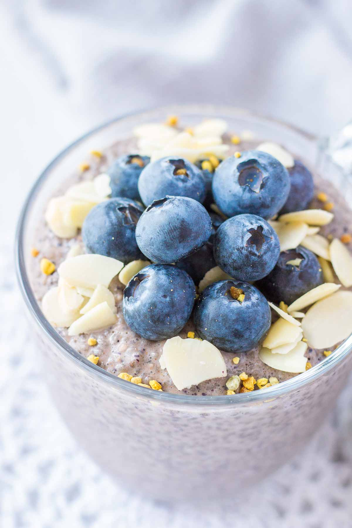 Close up of Blueberry Chia Pudding topped with fresh blueberries and almonds