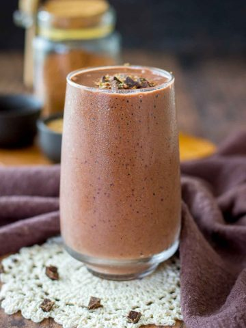 Cherry Chocolate Smoothie served in a glass topped with dark chocolate