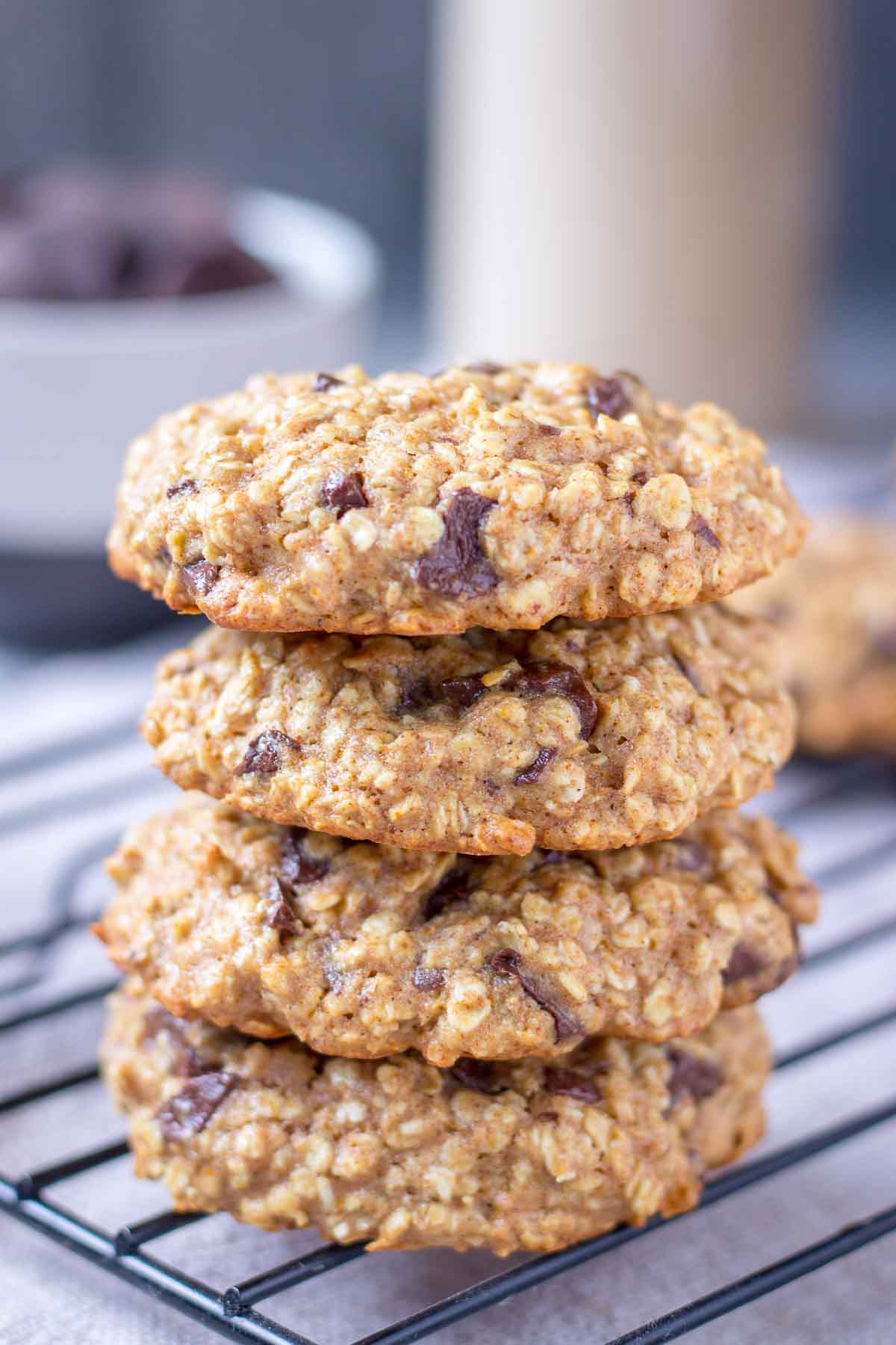Chocolate Chip Oatmeal Cookies stacked on a cooling tray