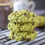 Matcha Chocolate Chip Cookies stacked on a cooling rack