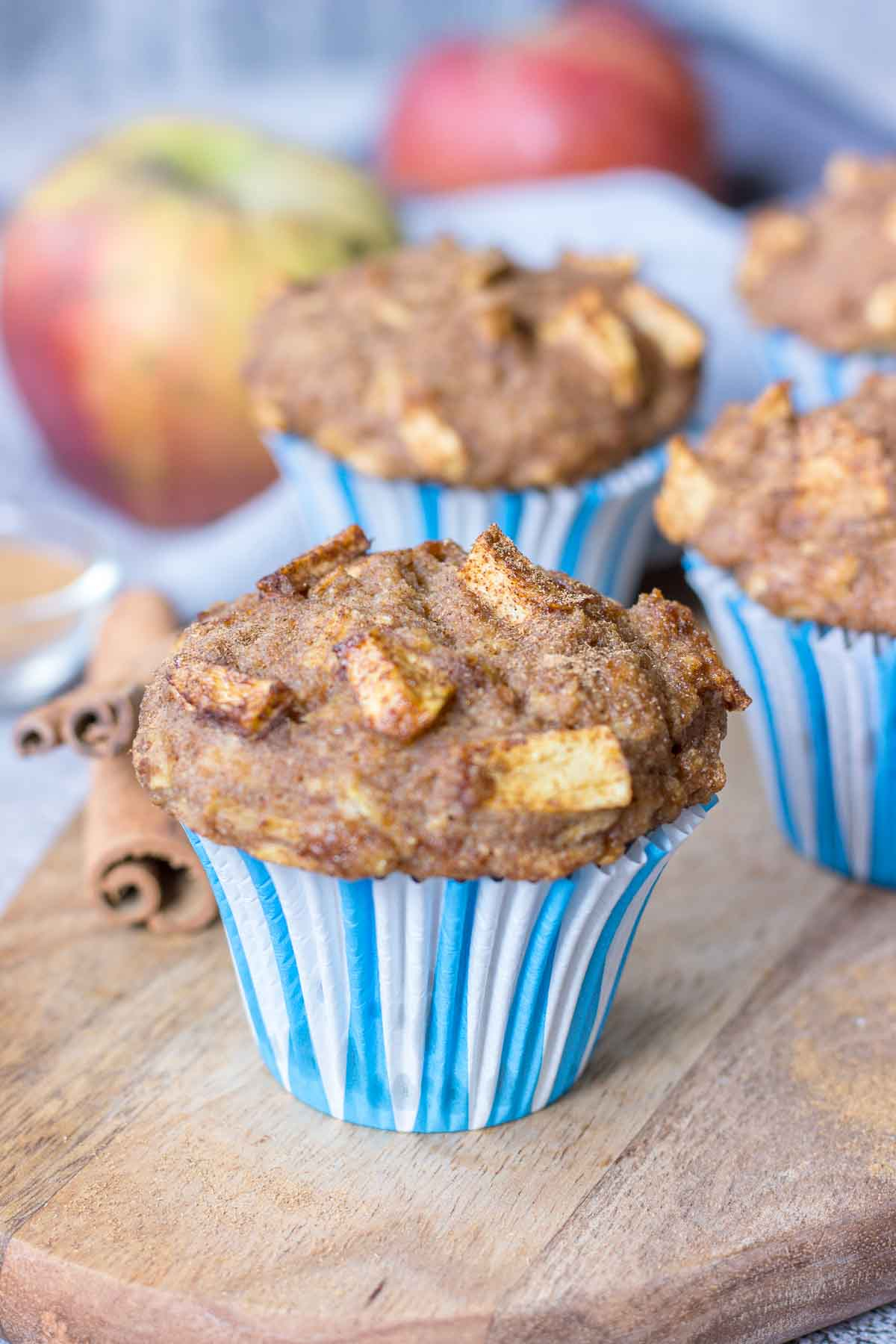 Apple Cinnamon Muffins served on a wooden plate
