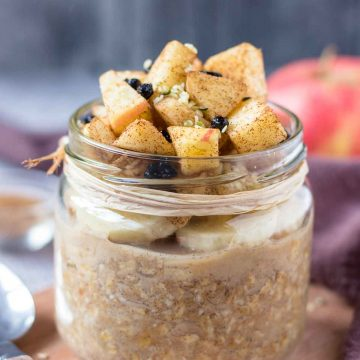 Apple Cinnamon Overnight Oats topped with banana slices and fresh diced apple