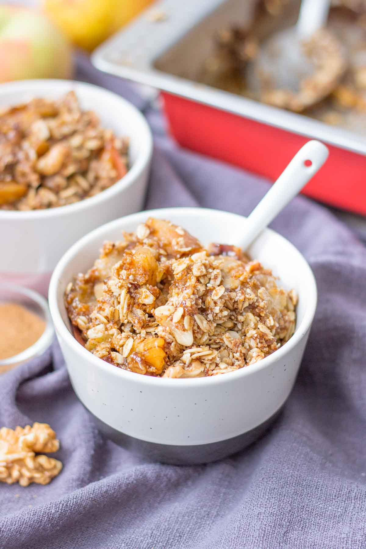 Apple Pear Crisp served in a bowl with a spoon