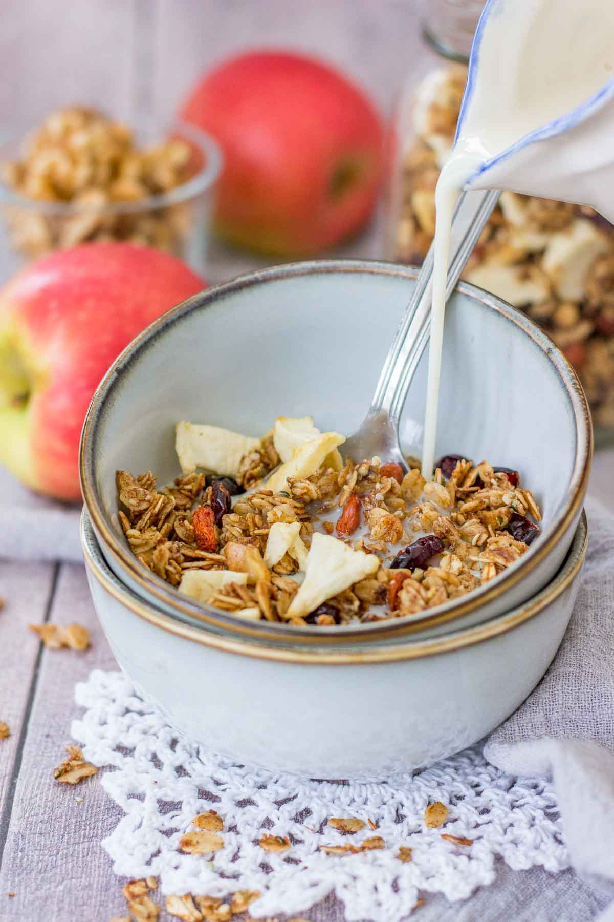 Apple Cinnamon Granola served in a bowl with a milk